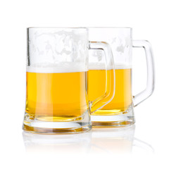 Two half glasses of fresh beer with foam isolated on white backg