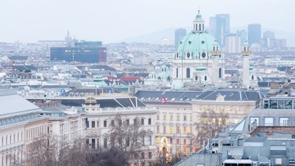 Domes of Karlskirche Church extend upward above city