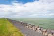 Leinwanddruck Bild - Dike protecting land against water