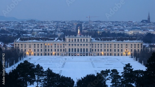 Schoenbrunn palace stands against evening city