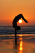 gymnast in sunset on beach