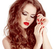 Portrait of sexy beautiful woman with red manicure nails, make-u