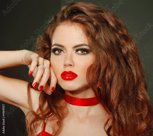 Fashion woman Portrait. Red Lips. Curly hair Style Girl