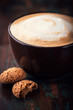 Latte coffee with biscotti