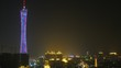 TV tower stands at center against night sky