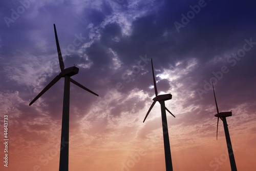 aerogenerator windmills on dramatic sunset sky