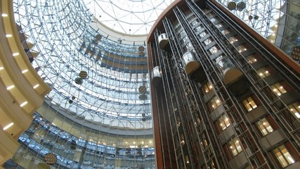 Lifts move downwards and upwards in business center