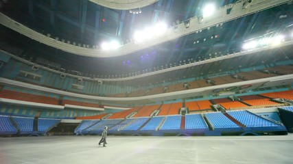 policeman and worker of protection go on huge empty hall