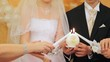 Newly-married couple holds big round candle