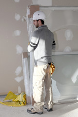 Man installing plaster divide