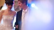 Newly-married couple dances together and echoes in disco