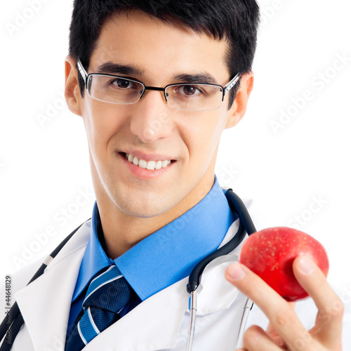 Happy smiling doctor with apple, on white
