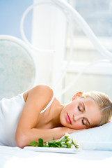 Sleeping woman with roses and valentine card