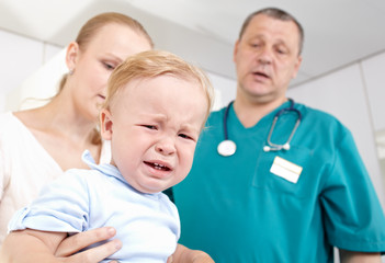 Boy is frightened and crying in a medical study.