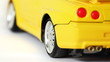 wheel of yellow toy radio-controlled car rotates back and forth
