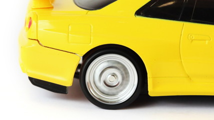 rear wheel of toy radio-controlled car slips on white