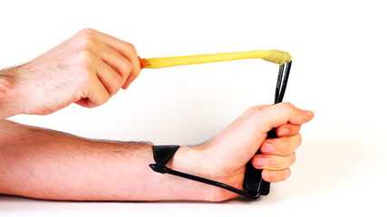 hands man pull elastic band of slingshot and shoot