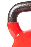 Closeup of the handle of the red kettlebell lying down on white