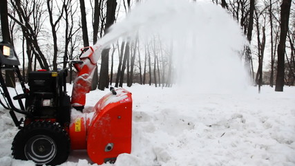 small manual machine that breaks large snow lumps