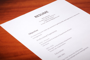 Closeup of resume on wooden table