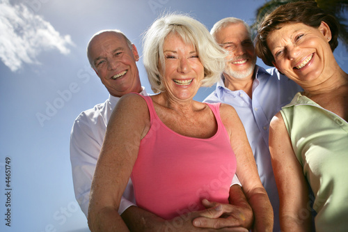 Two happy senior couples