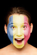 girl with romanian flag painted on her face