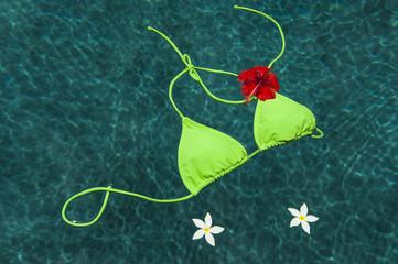 Green bikini floating with flowers