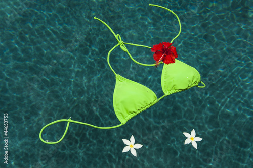 Green bikini floating with flowers