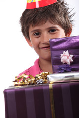 Boy with birthday presents
