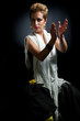 Portrait of beautiful young woman dancing flamenco studio shot