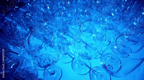 Many glasses in lit by blue light