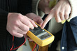 electricians using tester