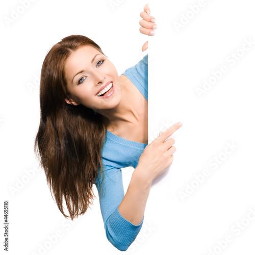 Leinwandbild Motiv Frau zeigt auf Werbeschild