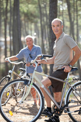 Two middle-aged men on bike ride