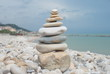 Stacked tower of rocks on stoned coast