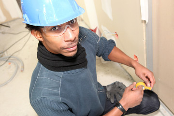 Electrician with yellow tape