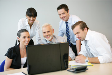 Business people at a laptop