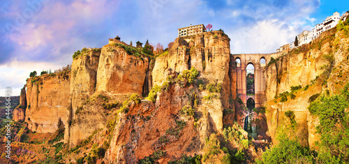 canvas print picture Panoramic view of the city of Ronda at sunset, Andalusia, Spain