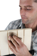 Carpenter with sandpaper