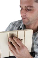 Carpenter with sandpaper