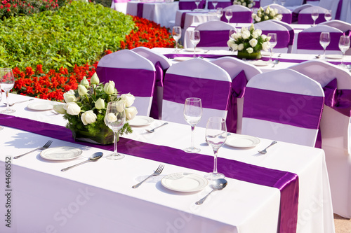 outdoor tables with served plate and wine glasses