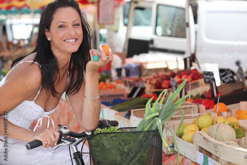 Brunette ob bike at an outdoor market