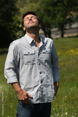 Man breathing in fresh air