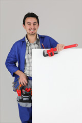 Man with blank board and toolbelt