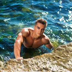 young attractive man staying in the sea