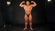 Bodybuilder shows muscular body in studio