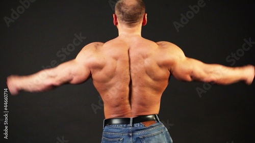 Bodybuilder shows muscular body