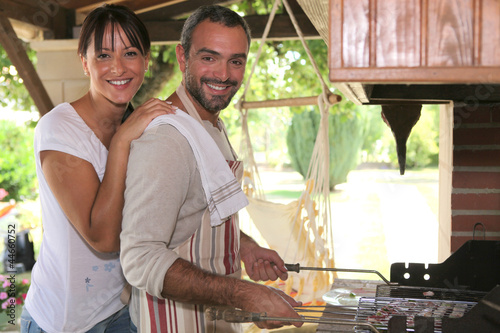Couple cooking on a barbecue