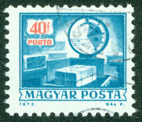 stamp printed by Hungary, shows postal boxes and scales