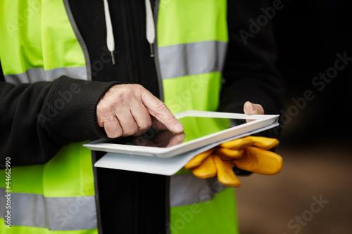 construction worker using digital tablet - 44662990